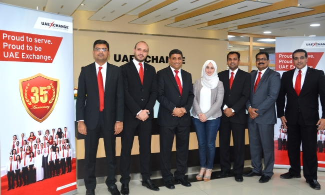 Mr. Varghese Mathew, Country Head, UAE Exchange-UAE (third from left) with staff during the launch of Arabic Call Centre