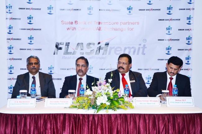 Officials of State Bank of Travancore and Oman UAE Exchange at the launch of FLASHremit at Hotel Haffa House, Muscat