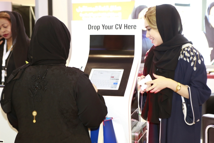An Emirati at the UAE Exchange stall at the National Career Exhibition
