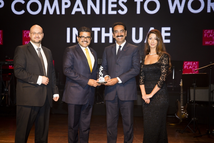 UAE Exchange CEO Promoth Manghat (left) and UAE Exchange President Y Sudhir Kumar Shetty (right) receiving the Great Place to Work Award